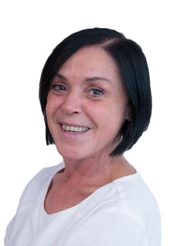Imagen de Irene, Auxiliar de Clínica e higienista, trabaja desde 1995 en la Clínica Dental Guisasola.